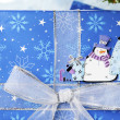 328 snowman sticker on christmas gift box — Stock Photo