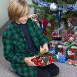 Boy opening his christmas gift — Stock Photo #19848713