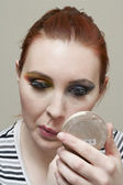 108 woman applying make up — Stock Photo