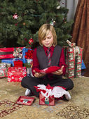 Cute boy with his christmas present — Stock Photo