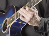 678 playing acoustic guitar — Stock Photo