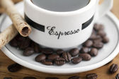 731 espresso and coffee beans — Stock Photo