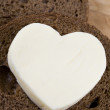 484 heart shaped butter on bread — Stock Photo