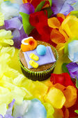 View of a cupcake with decorative miniature toppings surroun — Stock Photo