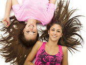 Portrait of girls lying on back — Stock Photo