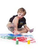 Elementary boy doing painting — Stock Photo