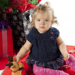 Stock Photo: Portrait of a baby girl sitting with teddy bear