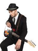 Homem de negócios pensativo com guitarra — Foto Stock
