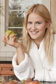 Happy woman holding apple — Stock Photo