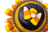 Cupcake decorated with candy corn and chocolate cream — Stock Photo
