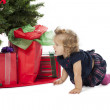 A baby girl crawling by the christmas tree — Stock Photo