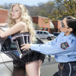Beautiful lady arrested by policewoman — Stock Photo #19874703