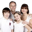 A close up portrait of a happy family smiling at the camera - Stockfoto