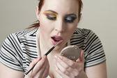 Woman applying lipstick — Stock Photo