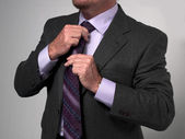 980 cropped image of a businessman adjusting necktie — Stock Photo