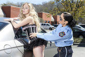 A beautiful lady arrested by a policewoman — Stock Photo
