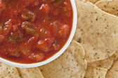 A bowl of salsa and chips — Stock Photo