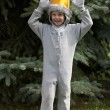 Playful elementary boy in fancy dress costume — Stock Photo #19907337