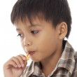 Boy eating candy — Stock Photo