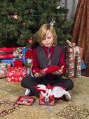 сute boy with his christmas present — Stock fotografie