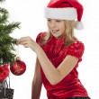 Cute girl touching christmas tree — Stock Photo