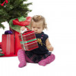 Stock Photo: View of a cute baby girl opening a christmas gift box