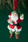 239 santa figurine hanging on christmas tree — Stock Photo