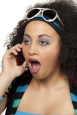 80s girl surprised on phone — Stockfoto