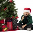 Boy eating christmas candy — 图库照片