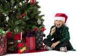 Boy eating christmas candy — Stock Photo