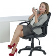 Businesswoman applying lipstick — Stock Photo