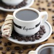 Stock Photo: Close up shot of coffee cups and beans