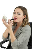 Businesswoman applying lipstick — Photo
