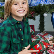 Cute boy holding his christmas present - ストック写真