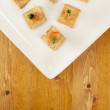 Smoked salmon on crackers — Stock Photo #19971649