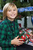 Cute boy holding his christmas present — Foto de Stock