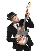 Young african american businessman playing guitar — Stock Photo