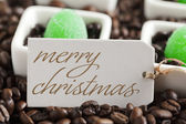 Coffee beans and green candies — Stock Photo