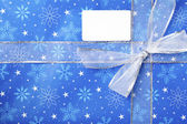 930 detailed view of blue christmas box with placard — Stock Photo