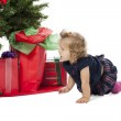 A baby girl crawling by the christmas tree — Stock Photo #20240877