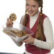 A teenage girl holding a tupperware of cookies — Stock Photo #20246221