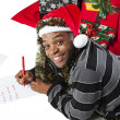African american man writing a letter to santa — Stock Photo