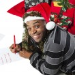 African american man writing a letter to santa — Stock Photo #20248189
