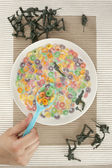 A bowl of cereal with toy soldiers — Stock Photo