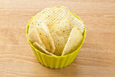 A bowl of sour cream and onion flavored chips — Stock Photo