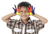 En pojke leende med en paint-hand — Stockfoto