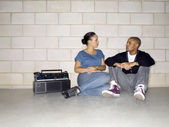 A couple sitting on the floor while talking — Stock Photo
