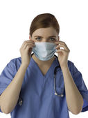 A female doctor wearing medical mask — Stock Photo