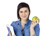 A lady holding book and apple — Stock Photo