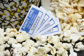 A spilled popcorn with movie tickets — Stock Photo